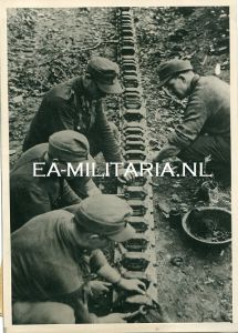 Press Photo of Soldiers Repairing a Halftrack
