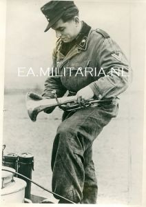 Press Photo of a Panzer Crewman with his Talisman